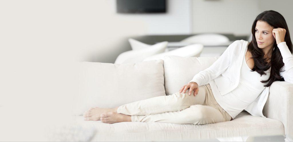 Woman Lays On Comfy Sofa